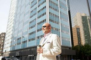Turkish developer Mike Sarimsakci in front of the 18-story tower at 211 N. Ervay in downtown Dallas.