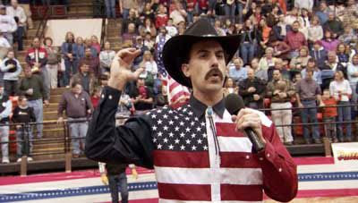 Borat sings his own version of the U.S. national anthem at a rodeo.