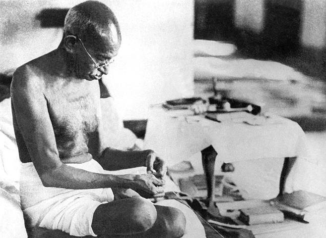 https://upload.wikimedia.org/wikipedia/commons/thumb/1/14/Gandhi_spinning_1942.jpg/800px-Gandhi_spinning_1942.jpg