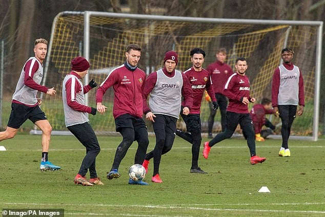 Entire Dynamo Dresden squad are forced into 14 days of quarantine after two players test positive for Coronavirus