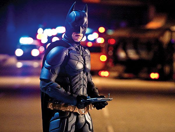 Batman employs his Badpad, courtesy of Apple®, in THE DARK KNIGHT RISES. (I'm kidding.)