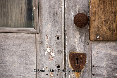 Rusty Doorknob and Keyhole of Historic Building on the National Road, Henry County, Indiana
