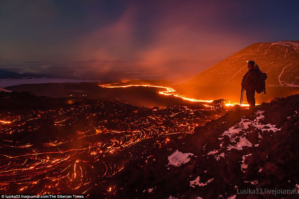 On the edge: One of the photographers standing watching the volcanic fields below