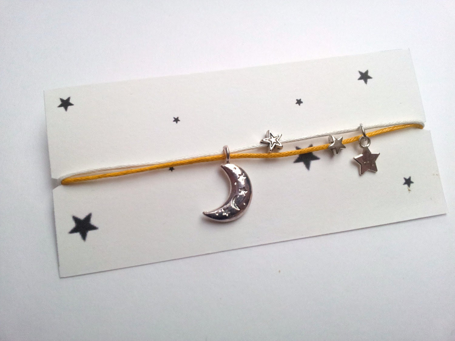 Fly me to the Moon friendship bracelet on waxed cotton cord