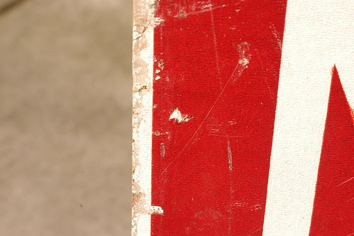 red flecks on sign