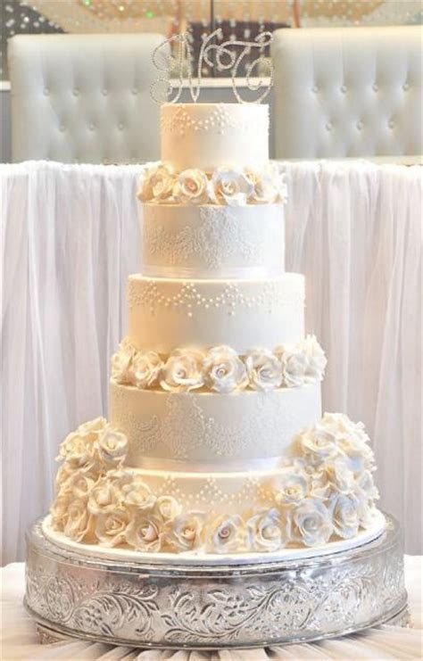 Five tier elegant ivory wedding cake with white roses and