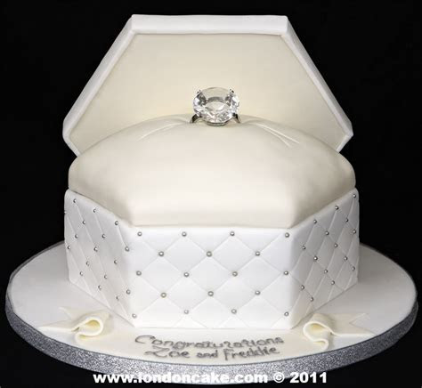 Like this Ring Box Engagement Cake as the top layer of the