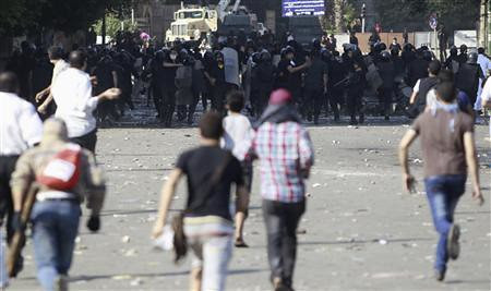 Egyptian youth fight riot police defending the US embassy in Cairo. Thousands demonstrated on September 14, 2012. by Pan-African News Wire File Photos