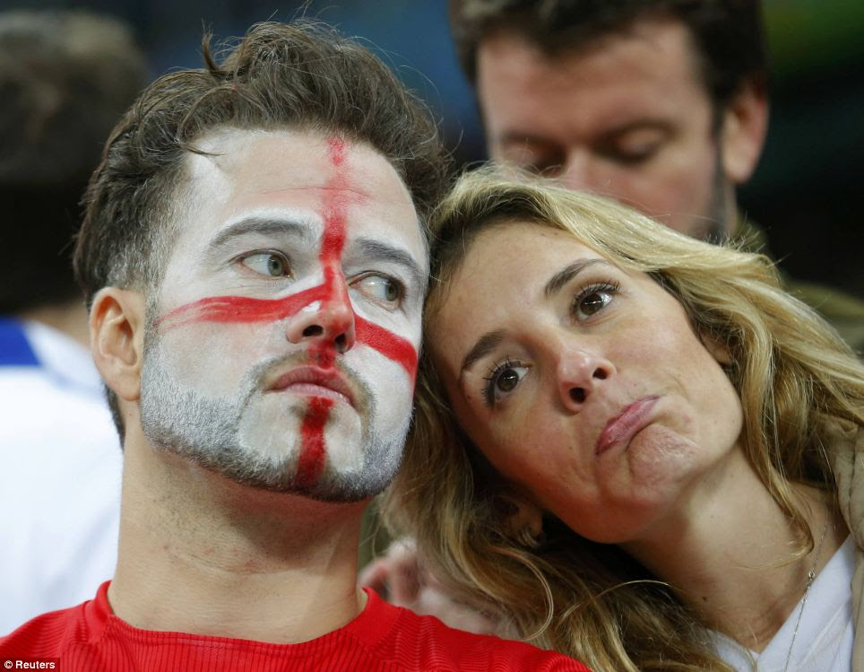 Disappointment: Two England fans react to their team losing to Uruguay during their 2014 World Cup
