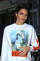 kendall jenner brightens up outfit with orange bag 01