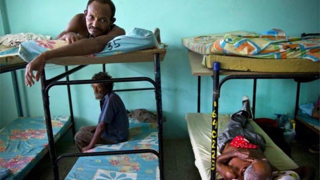 People wait in a shelter ahead of Hurricane Matthew in Guantanamo, Cuba