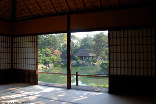 A pond and a rustic house seen from the inside, at Katsura Imperial Villa, in Kyoto