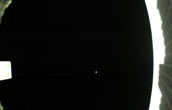 An image of Earth and the Moon as seen by the MarCO-B CubeSat, also known as 'WALL-E,' from 621,371 miles (1 million kilometers) away...on May 9, 2018.