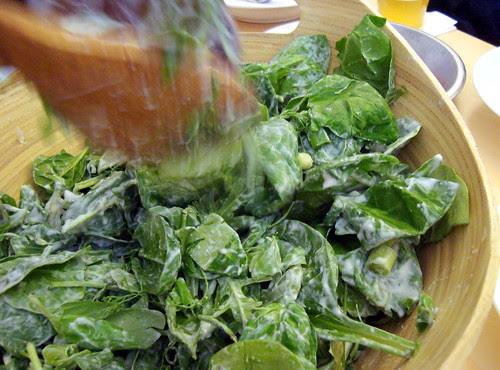 Five-Greens Salad Being Tossed