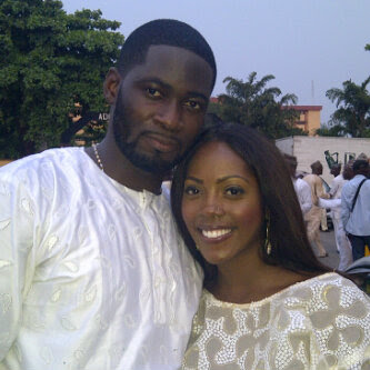TIWA SAVAGE & TEE BILLZ LOCKED IN A CLOSE EMBRACE FOR THE CAMERAS AT A PUBLIC EVENT