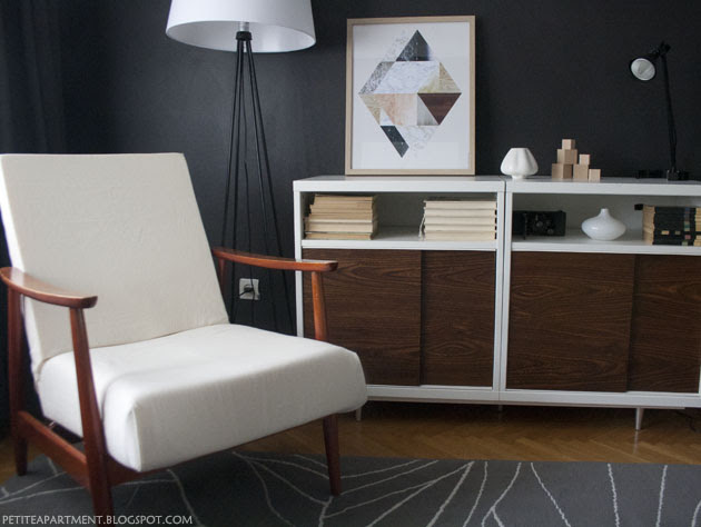 mid century modern chair and cabinet in the living room with black dark grey walls apartment inspiration ikea besta gislev