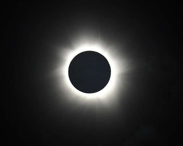 Totality is shown during the solar eclipse at Palm Cove in Australia's Tropical North Queensland on November 14, 2012. Eclipse-hunters have flocked to Queensland's tropical northeast to watch the region's first total solar eclipse in 1,300 years on November 14, which occurred as the moon passed between the earth and the sun, casting a shadow path on the globe and lasting for a maximum on the Australian mainland of 2 minutes and 5 seconds. Photo: Greg Wood, AFP/Getty Images / SF