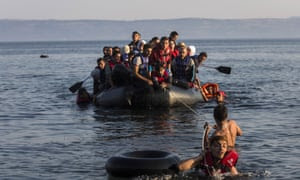 An overcrowded dinghy with refugees
