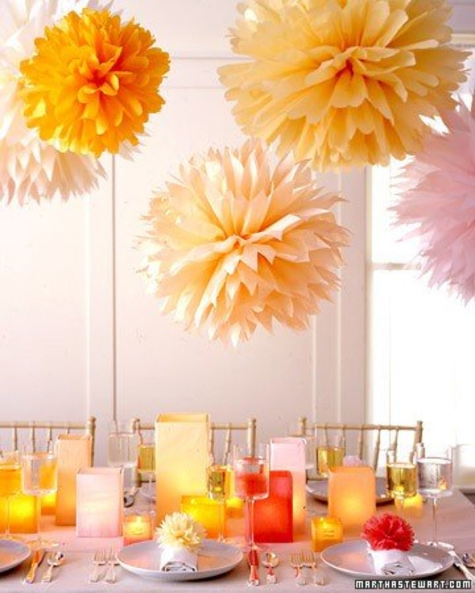 Accordion fold stacks of tissue paper to make these giant pom-poms. All you need is tissue paper, floral wire, and monofilament thread. Click the link to get the full how to and additional instructions on making the matching pom-pom napkin holders.