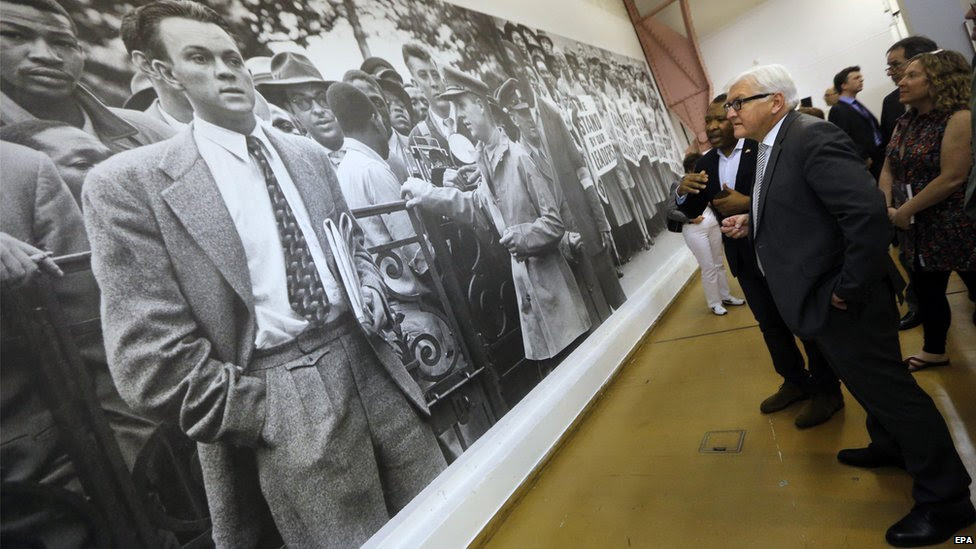 "German Foreign Minister Frank-Walter Steinmeier (C) pictured during his tour of the ""Rise and Fall of Apartheid"" exhibition at Museum Africa in downtown Johannesburg, South Africa, 20 November 2014"