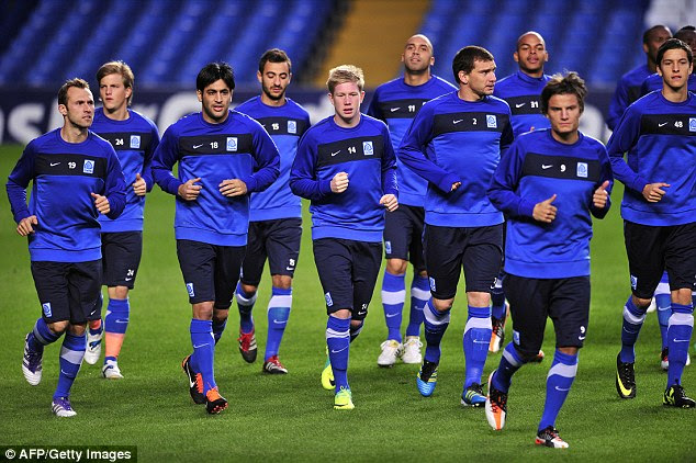 De Bruyne (centre) trains with his former club Genk as an emerging talent aged 20