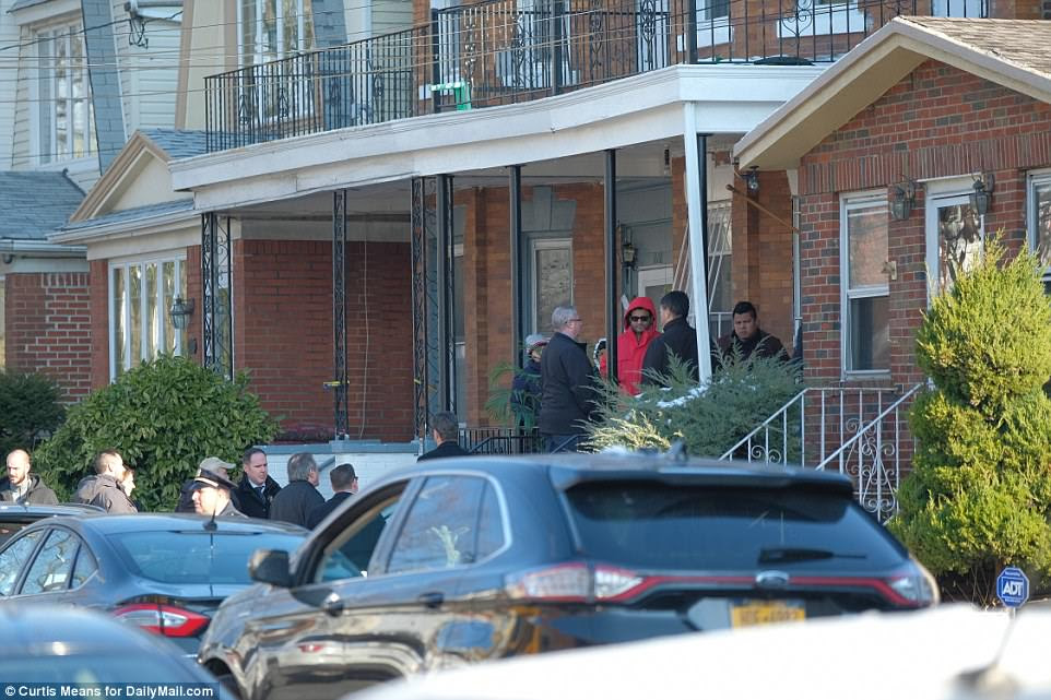 Police were seen speaking to residents at the home on the porch Monday morning