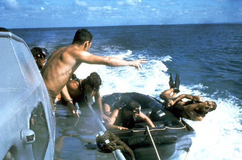 File:US Navy SEALs SEAL jumps over side boat.jpg