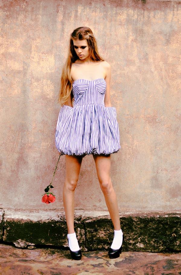 Lulu in chains, blue striped dress.