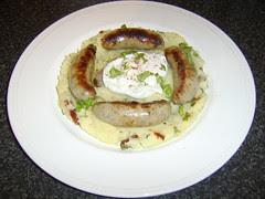 Pork and Leek Sausages on Garlic, Coriander and Sun Dried Tomato Mash