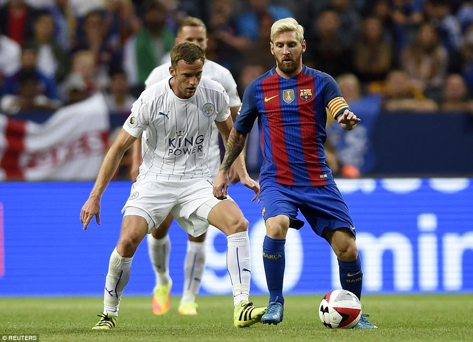 Barcelona captain Lionel Messi plots his side's next move as Andy King looks to exert some pressure during the first-half