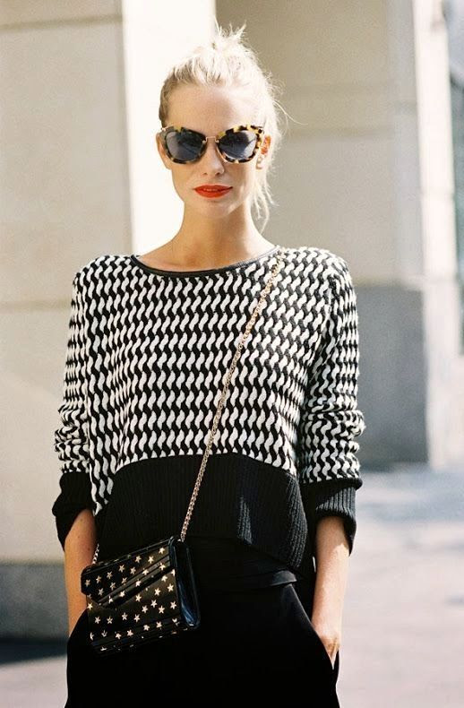 Le Fashion Blog Street Style Black And White Knit Sweater Poppy Delevingne Miu Miu Cat Eye Sunglasses Bright Red Lipstick Star Print Bag By Vanessa Jackman photo Le-Fashion-Blog-Street-Style-Black-And-White-Poppy-Delevingne-Miu-Miu-Sunglasses-Red-Lipstick-By-Vanessa-Jackman.jpg