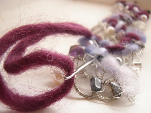 sew; a needle pulling thread
