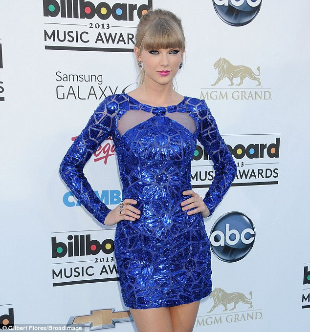 Peekaboo: Taylor Swift, known for her conservative preppy style, rocked a blue-sequin Zuhair Murad mini-dress which featured sheer paneling on the chest