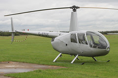 G-STUY - 2004 build Robinson R44 Raven II, visiting Barton & parked by the VC