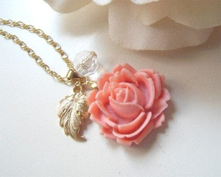 Rose Sunrise. Dainty pale pink rose bud pendant with brass leaf and clear crystal necklace