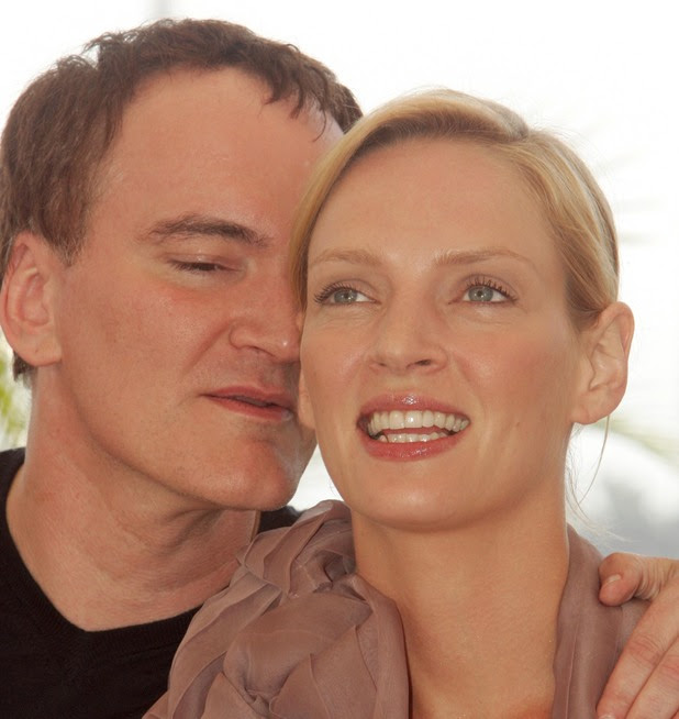 Quentin Tarantino and Uma Thurman during 2004 Cannes Film Festival - 'Kill Bill Vol. 2' - Photocall at Palais Du Festival in Cannes, France. (Photo by George Pimentel/WireImage)