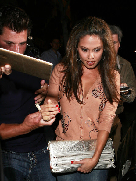 Vanessa Minnillo and Nick Lachey are seen leaving Il Sole restaurant in West Hollywood.