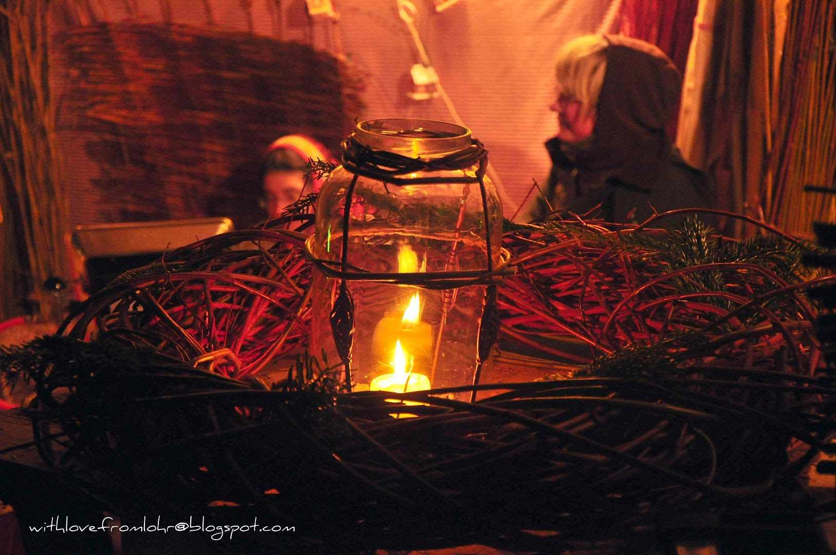 01.12.11, A family preparing Rattan wreaths at the Christmas market.