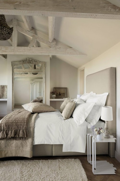 A beautiful light and airy bedroom decorated in...