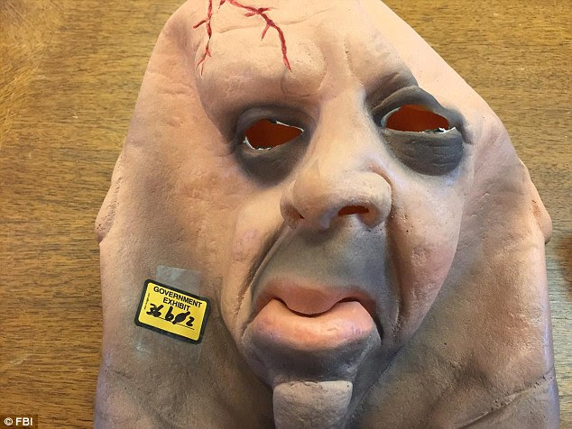 This plastic Halloween mask was one of the face covers the gang used when they staged their attacks