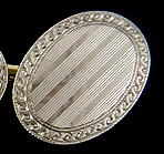 Carrington platinum and gold oval cufflinks. (J9034)