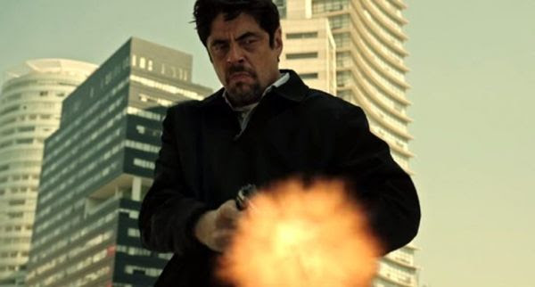 Alejandro, played by Benicio Del Toro, opens fire on a hapless member of the Mexican drug cartel in 2018's SICARIO: DAY OF THE SOLDADO.