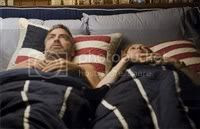 Frances McDormand and George Clooney in the same bed for Burn After Reading. :)