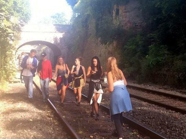 The scene on the track in Bristol after a group of students abandoned a train