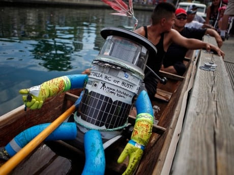 Hitchbot, Canada's most famous hitchhiking robot, arrives in a cedar canoe with Songhees Nation members for a traditional Coast Salish at Victoria's inner harbour.