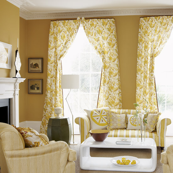 Yellow-floral-living-room-with-striped-sofa-yellow-couches-carpeted-floor-white-modern-chic-table-floral-curtains-and-other-decorations