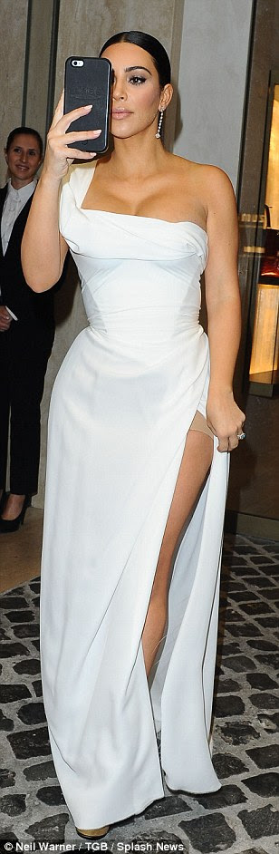 All white on the night: The stunning mother-of-two looked sensational as she slipped her famous curves into a very figure-hugging white Vivienne Westwood number