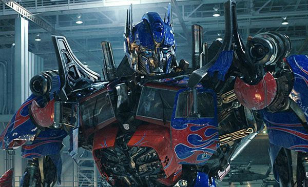 Optimus Prime stands tall inside the NEST hangar in TRANSFORMERS: DARK OF THE MOON.