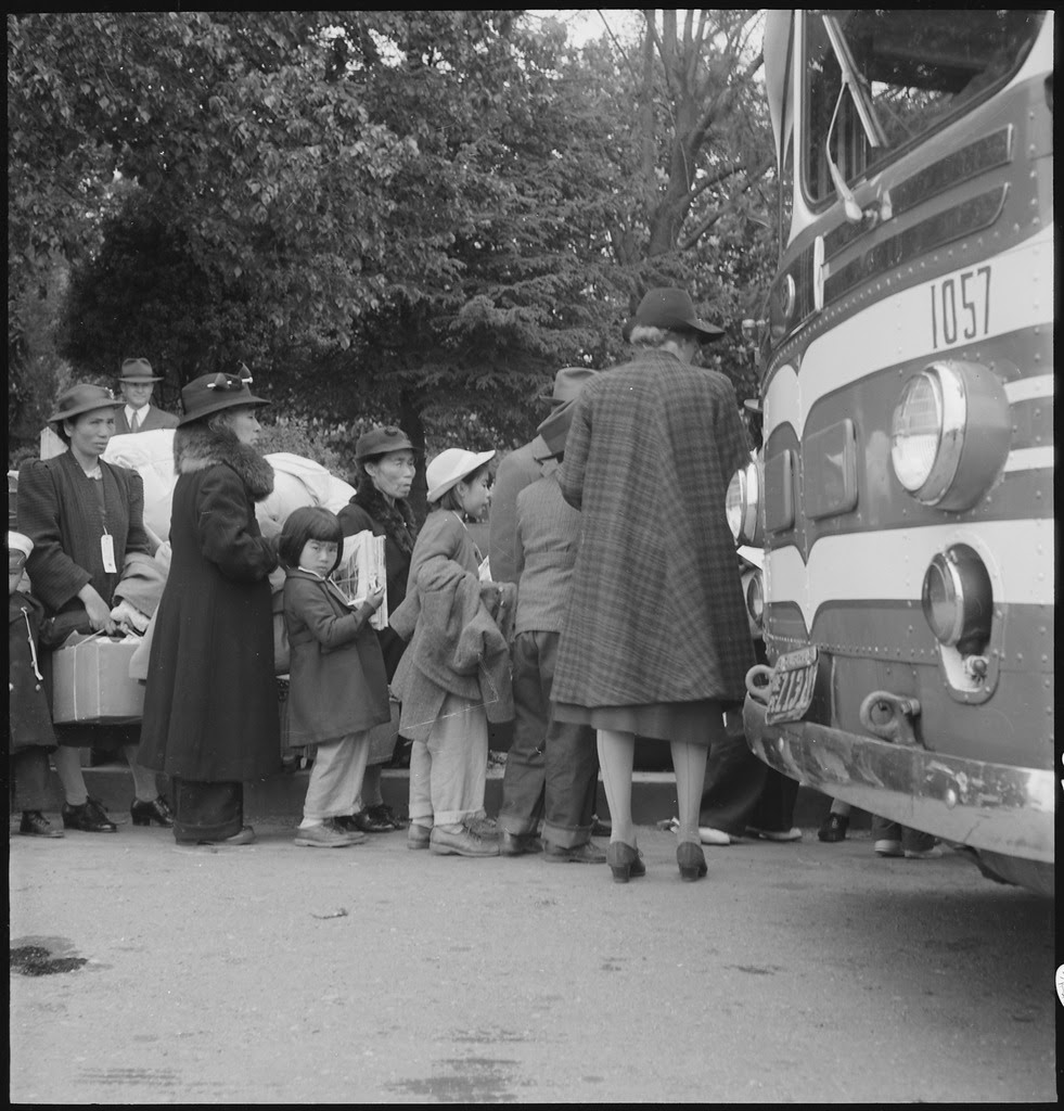 http://upload.wikimedia.org/wikipedia/commons/thumb/f/fc/Hayward%2C_California._Farm_families_of_Japanese_ancestry_are_being_checked_into_the_evacuation_buses_._._._-_NARA_-_537521.tif/lossy-page1-981px-Hayward%2C_California._Farm_families_of_Japanese_ancestry_are_being_checked_into_the_evacuation_buses_._._._-_NARA_-_537521.tif.jpg