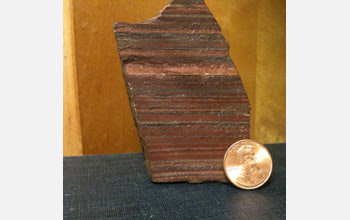 Close-up of a sample of 2.7 billion-year-old iron formation from Zimbabwe; red is hematite.